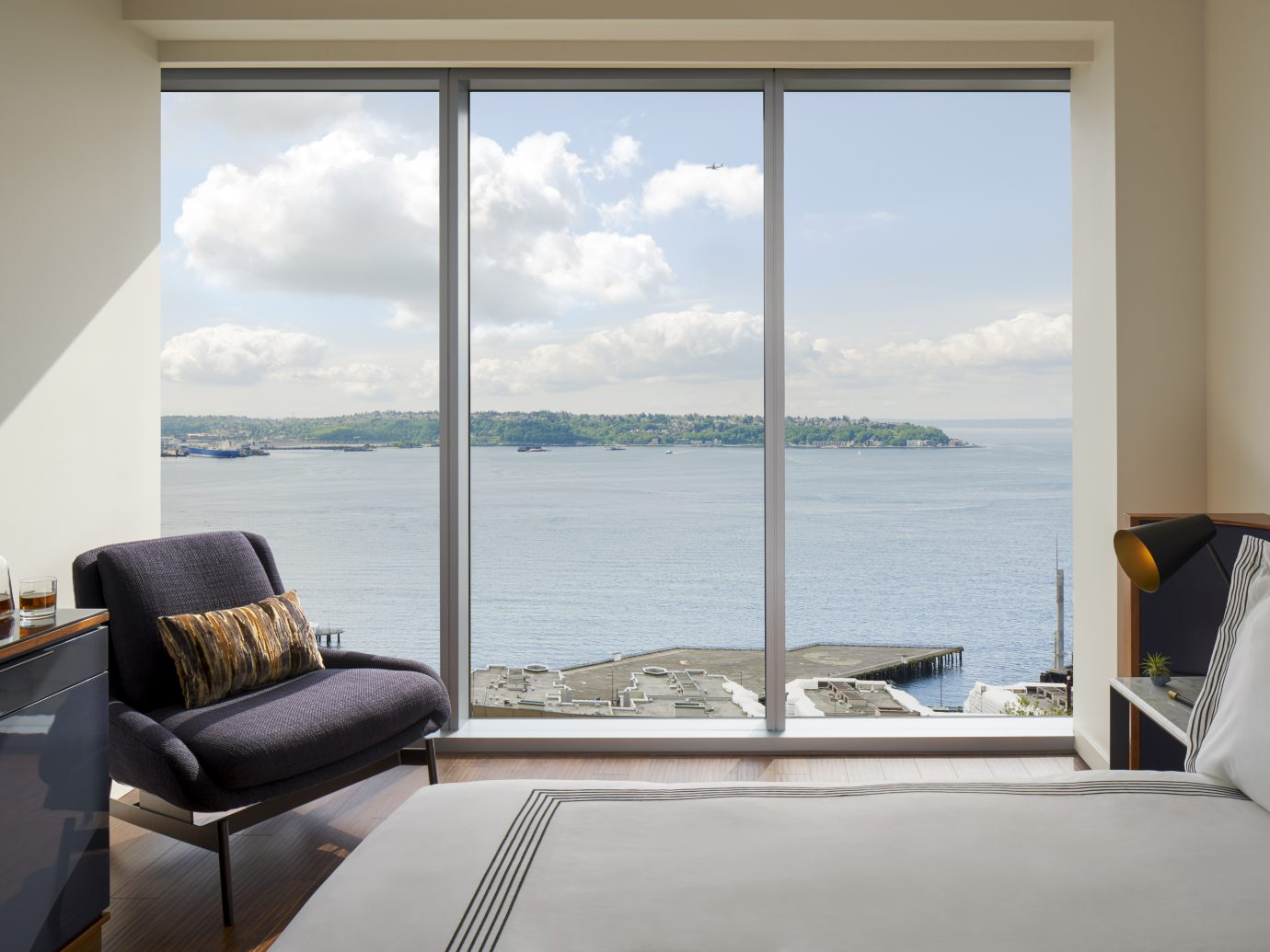 Interior room space at Thompson Seattle looking over body of water