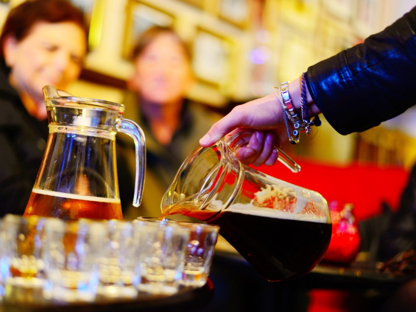 Person pouring beer from a pitcher