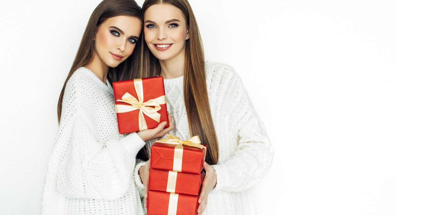 Two beautiful women with hjoliday gifts