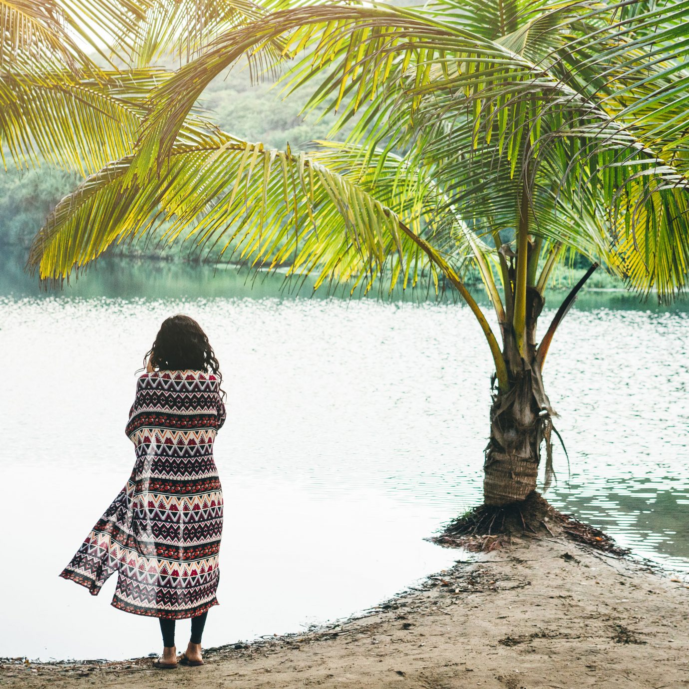 Woman on the shore of a tropical lagoon in Goa, India