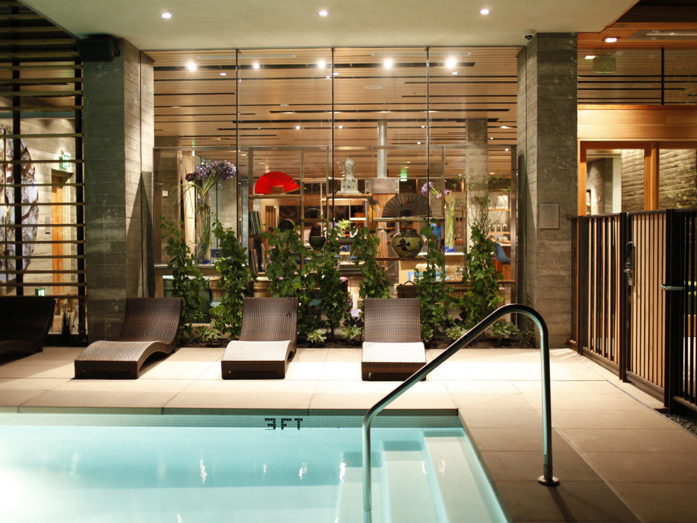 Pool and chairs inside at H2 Hotel