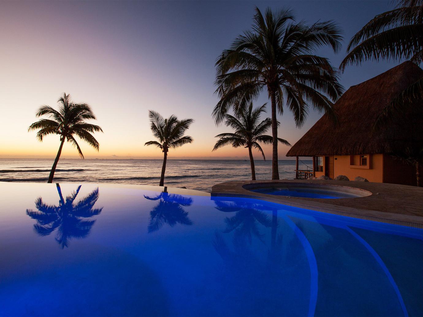Mahekal Beach Resort pool at dusk