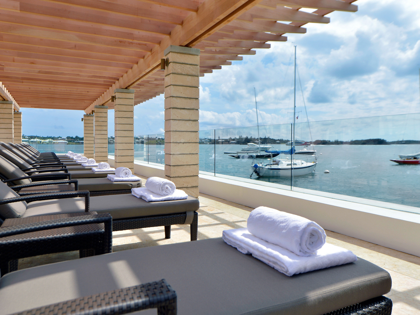 Outdoor lounge area overlooking boats at Hamilton Princess