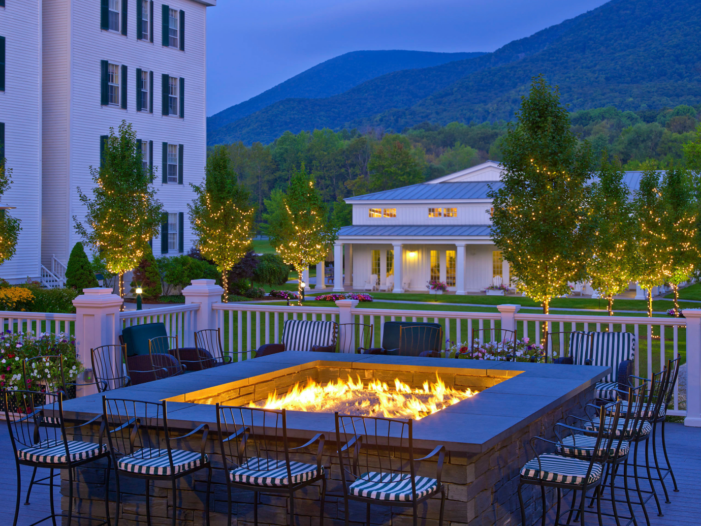 Outdoor fire pit at dusk at Equinox Golf Resort & Spa