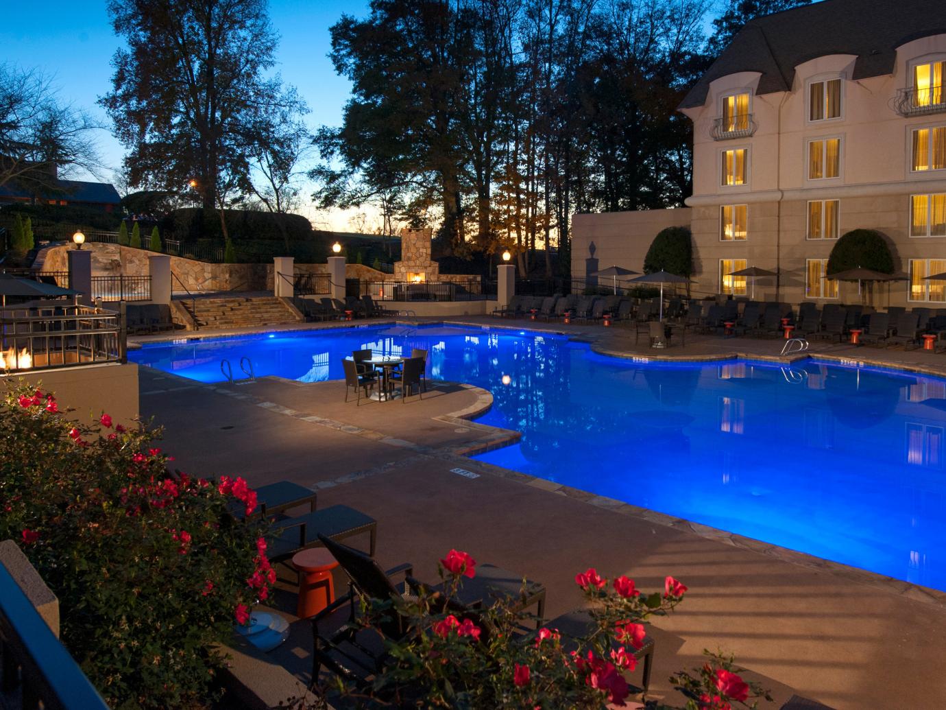 Outdoor swimming pool at night at Chateau Elan Winery & Resort
