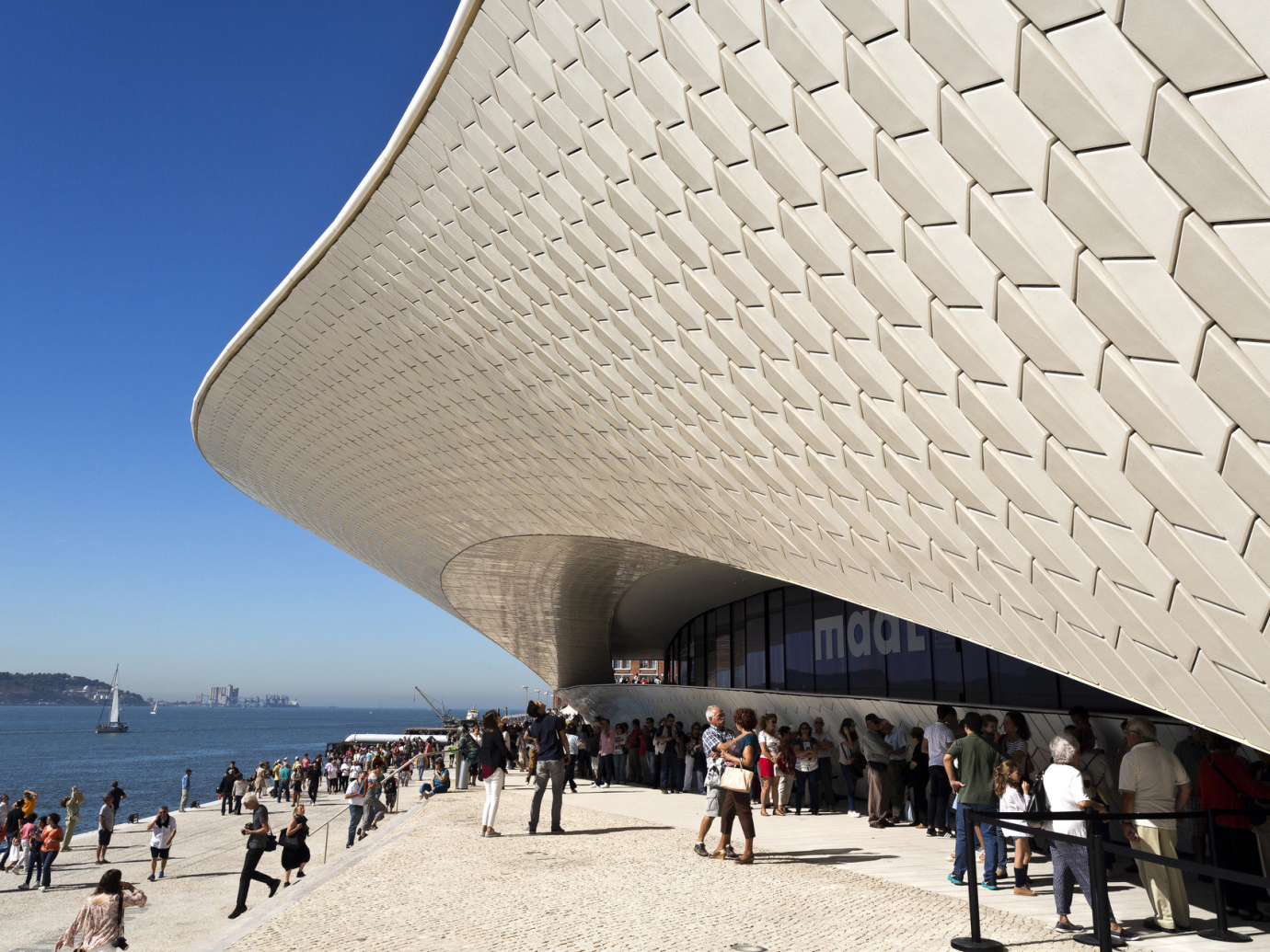 Exterior of the MAAT Museum surrounded by people