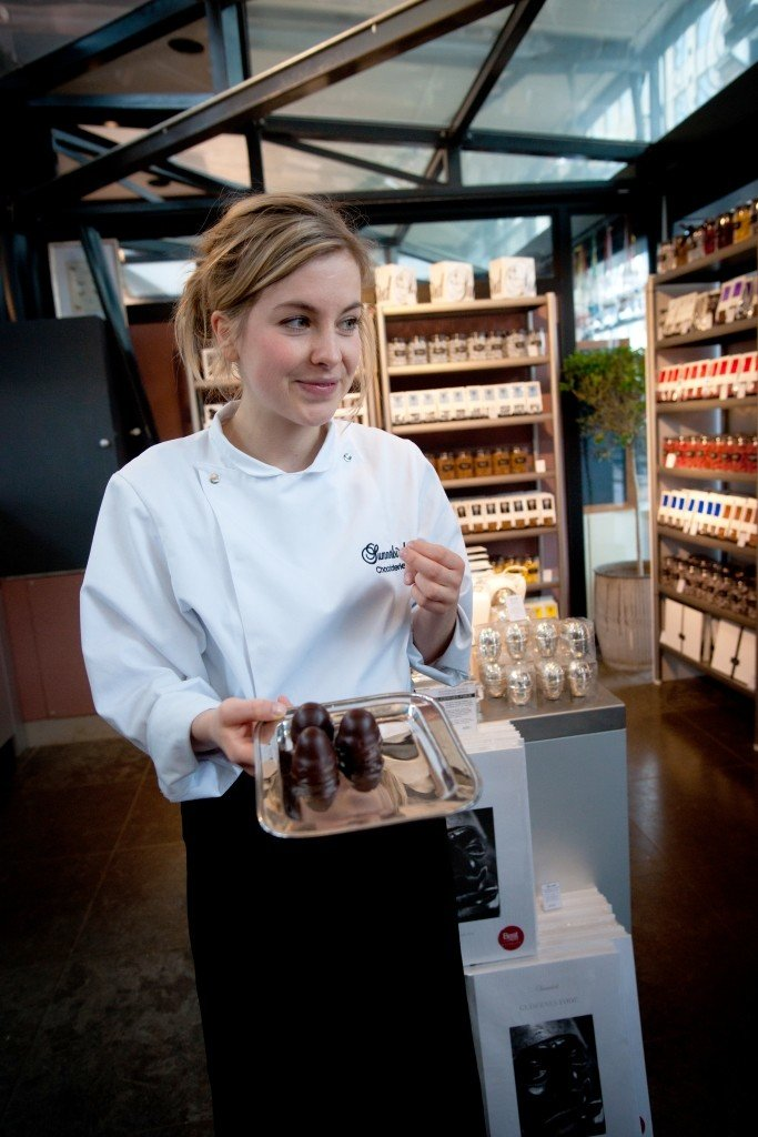 woman with a tray of chocolates