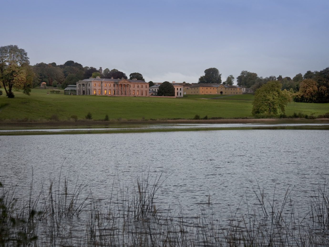 View of pond and buildings at Ballyfin in Ireland