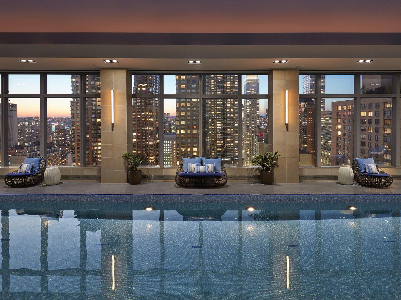 Wellness pool at dusk overlooking NYC at Mandarin Oriental
