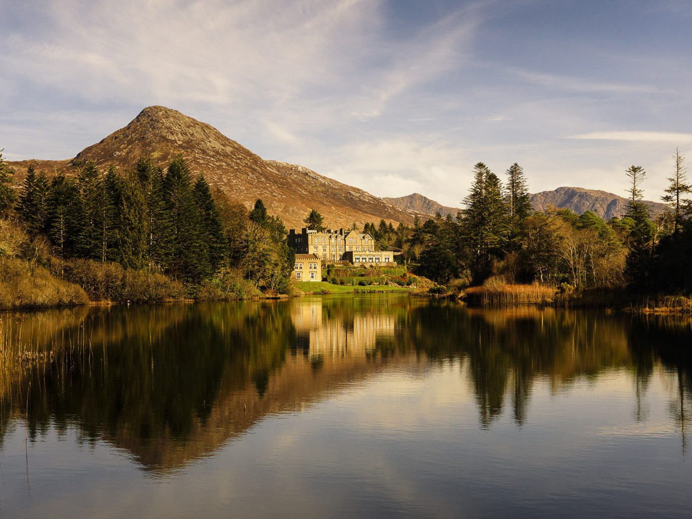 View of lake and grounds of Ballynahinch Castle in Ireland