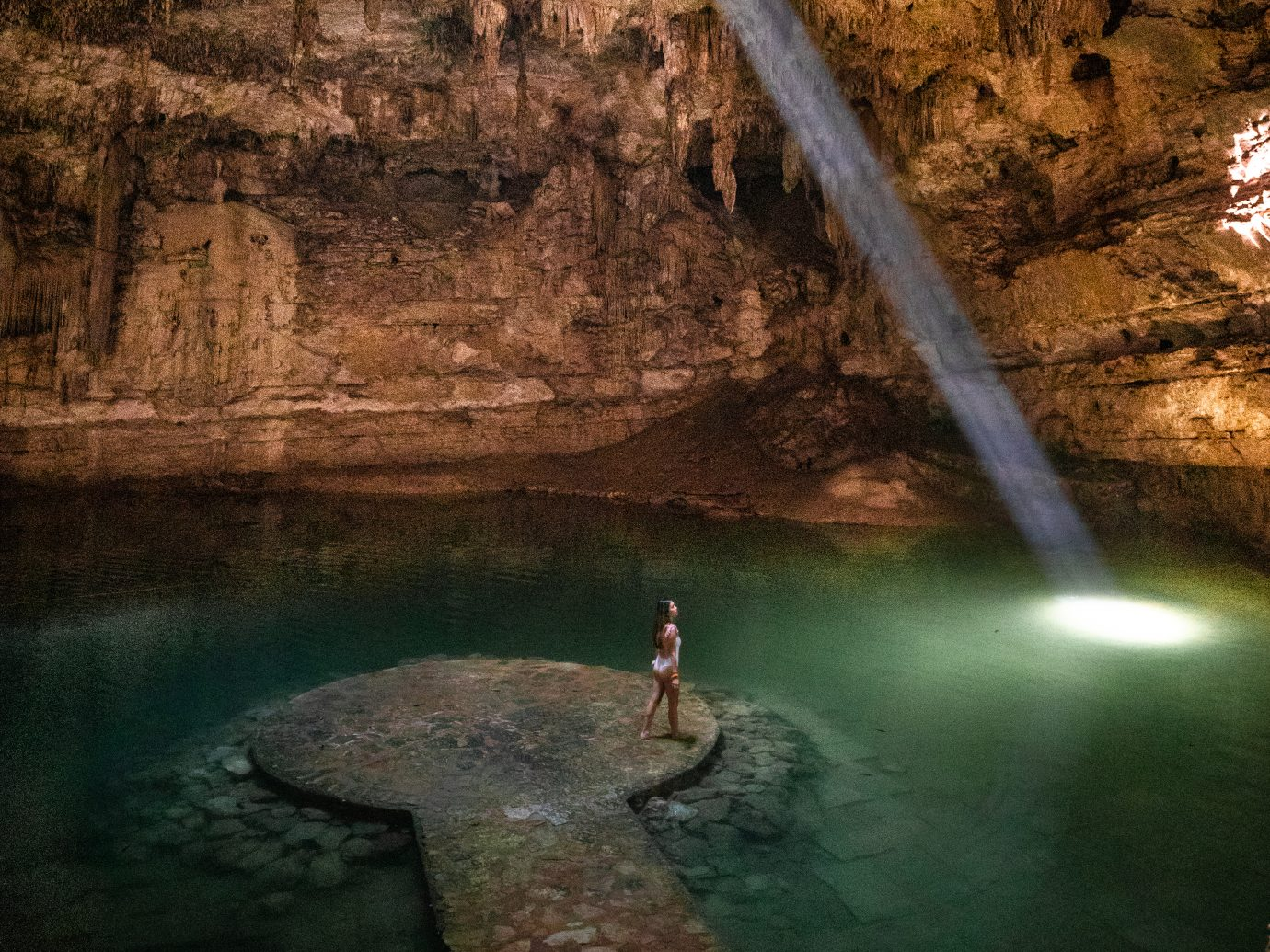 Girl standing in a cenote