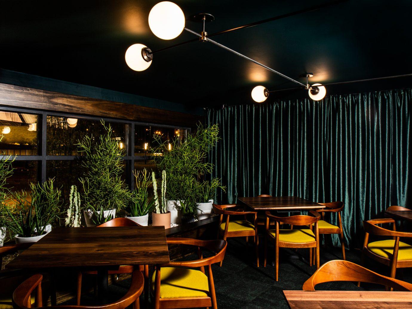 Dark dining room with velvet green curtains