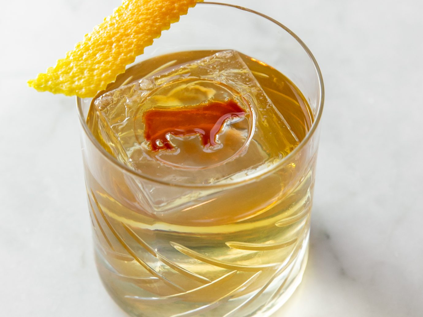 Old fashion with a cow decoration in drink