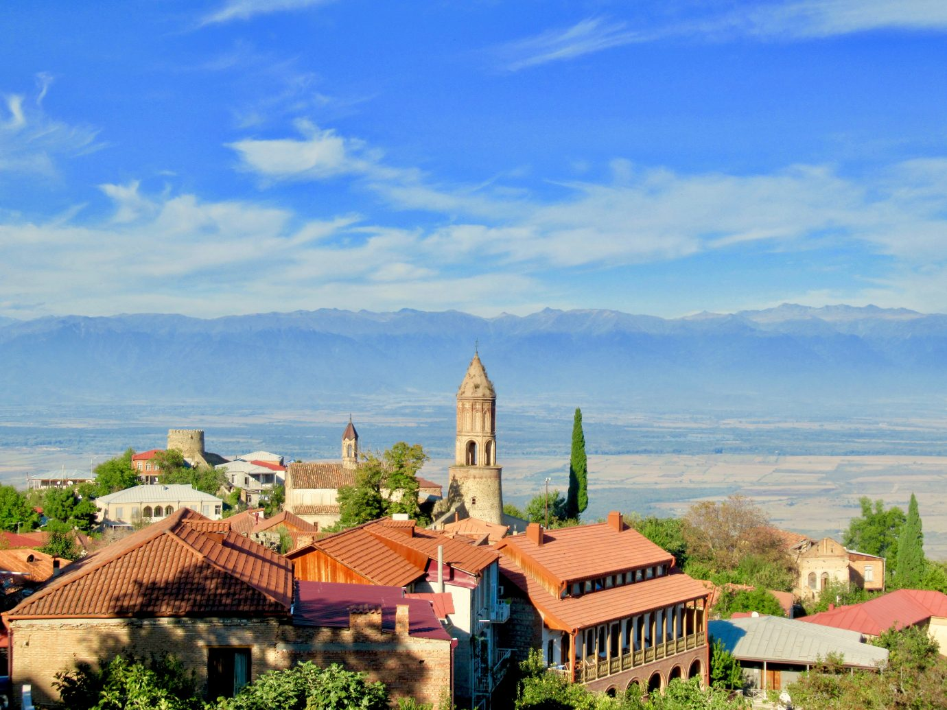 Rooftop views of Sighnaghi with mountains in the background