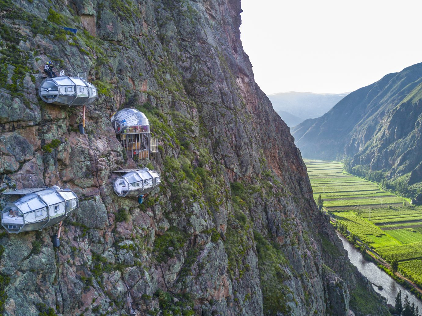 Skylodge pods hanging on the side of a mountain