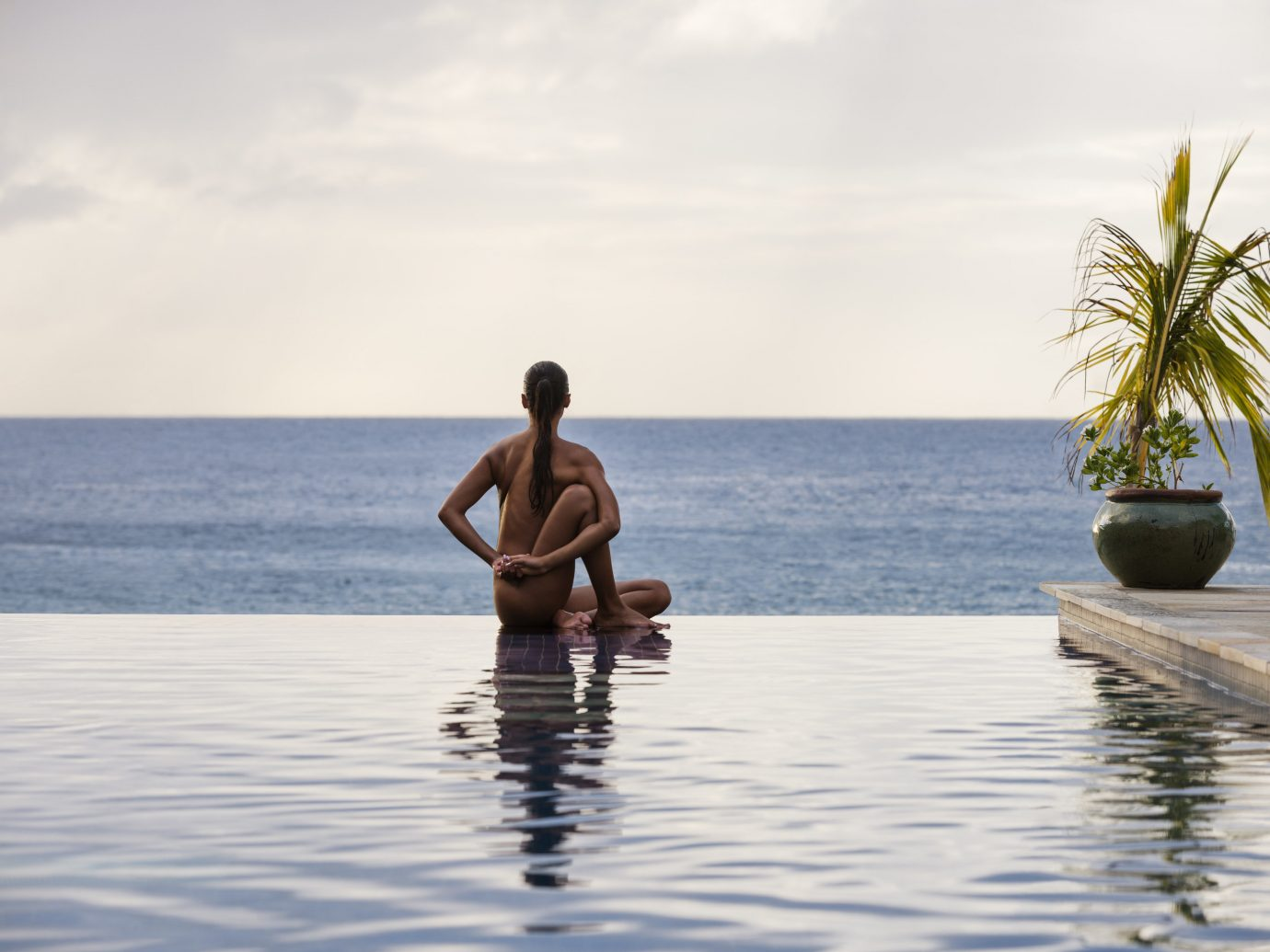 woman in infinity pool at The BodyHoliday, St. Lucia