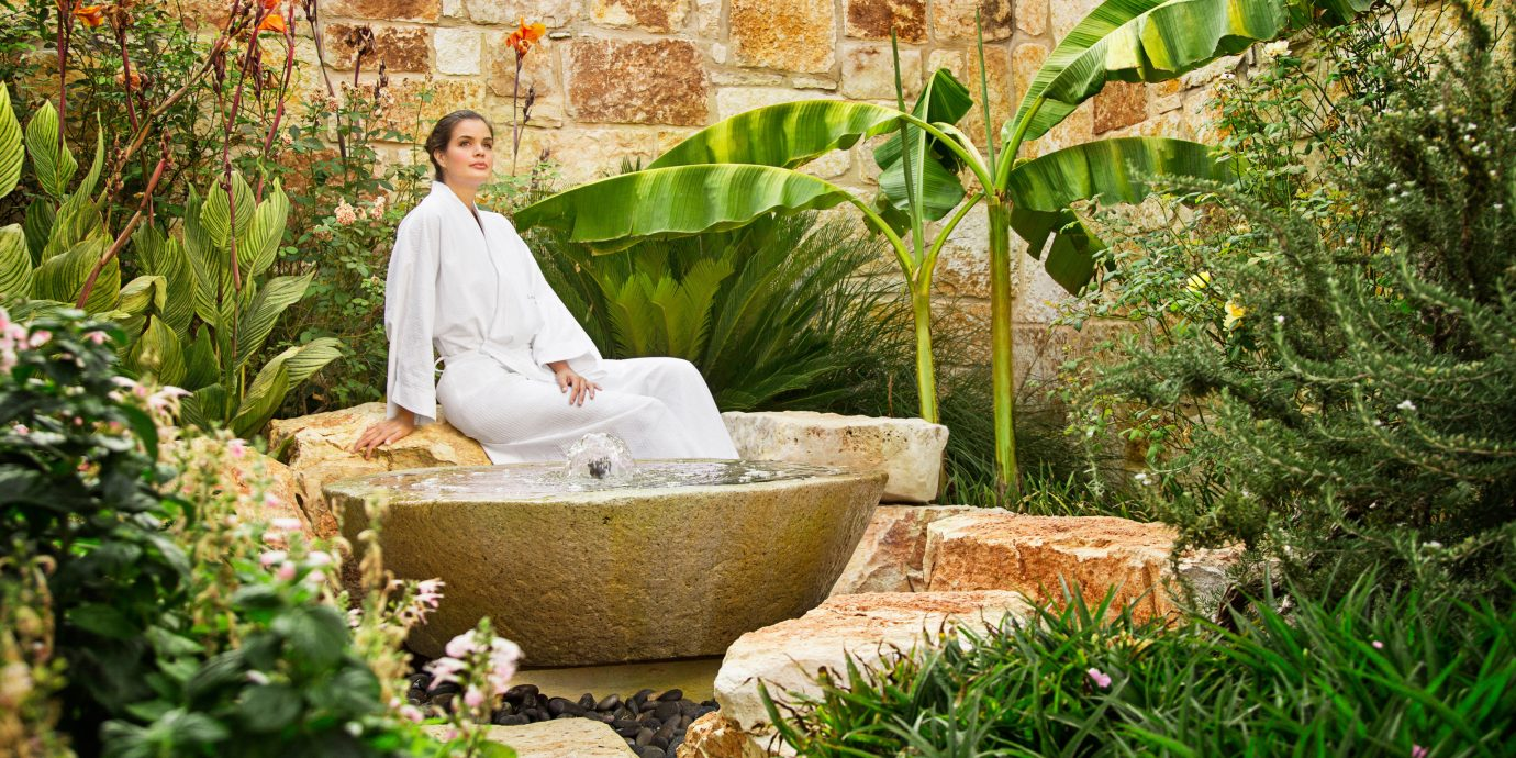woman in the garden at Lake Austin Spa Resort