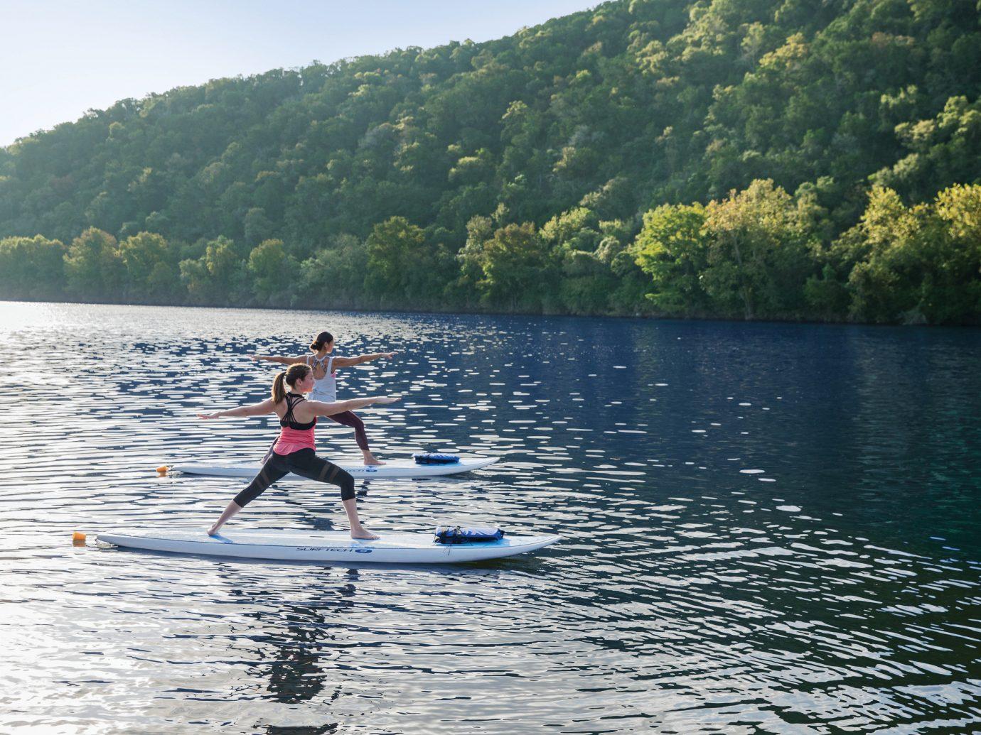 paddle boarding at Lake Austin Spa Resort