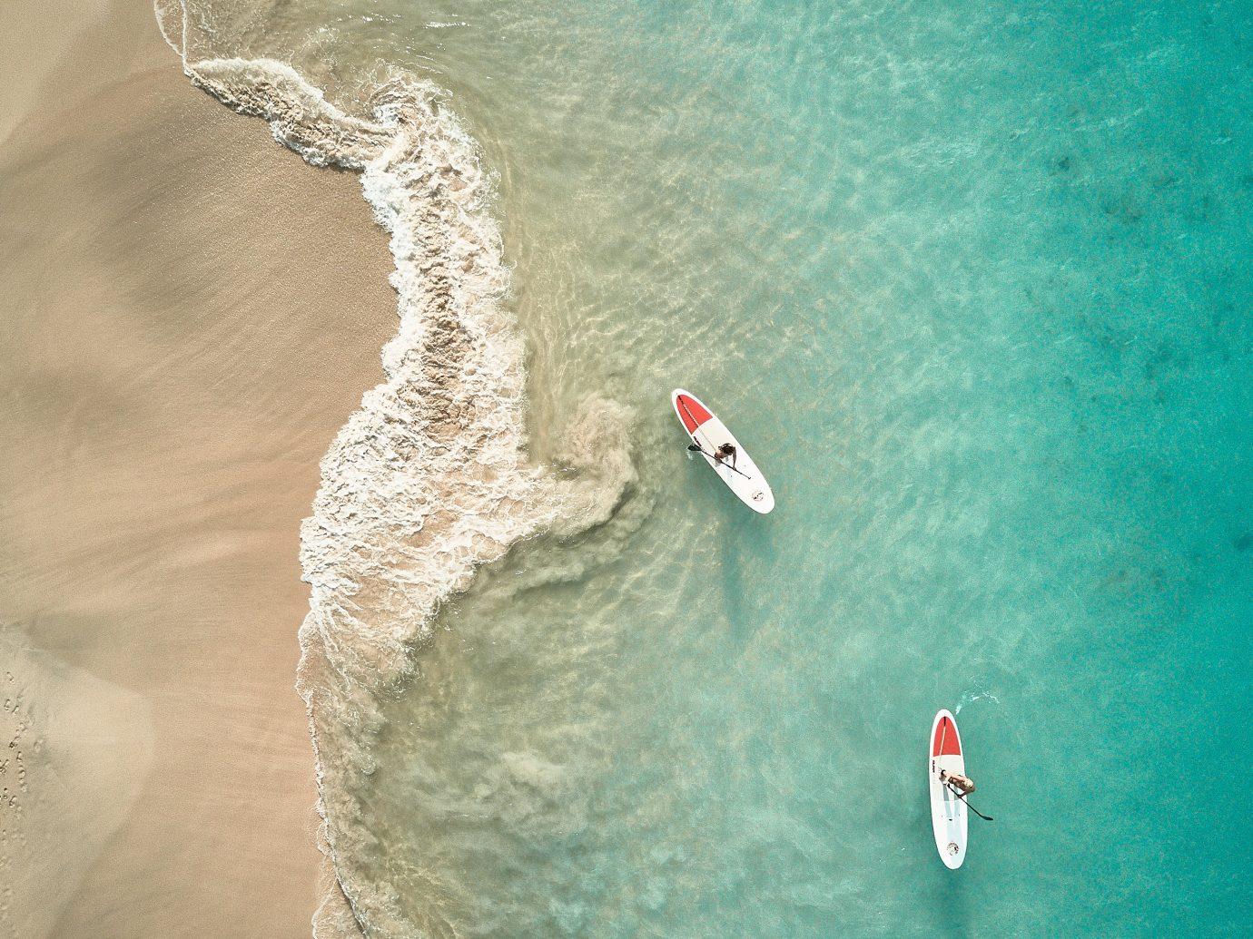 two people paddleboarding taken overhead