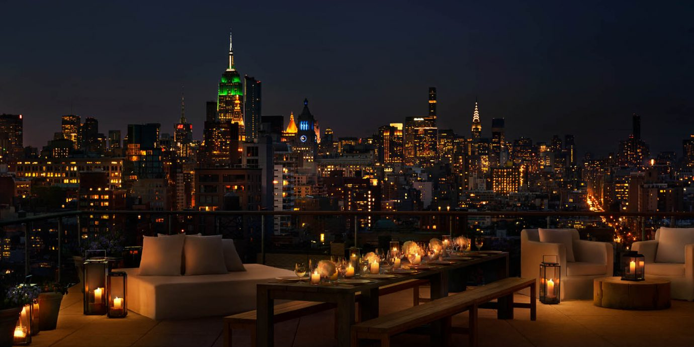 rooftop at PUBLIC overlooking NYC at night
