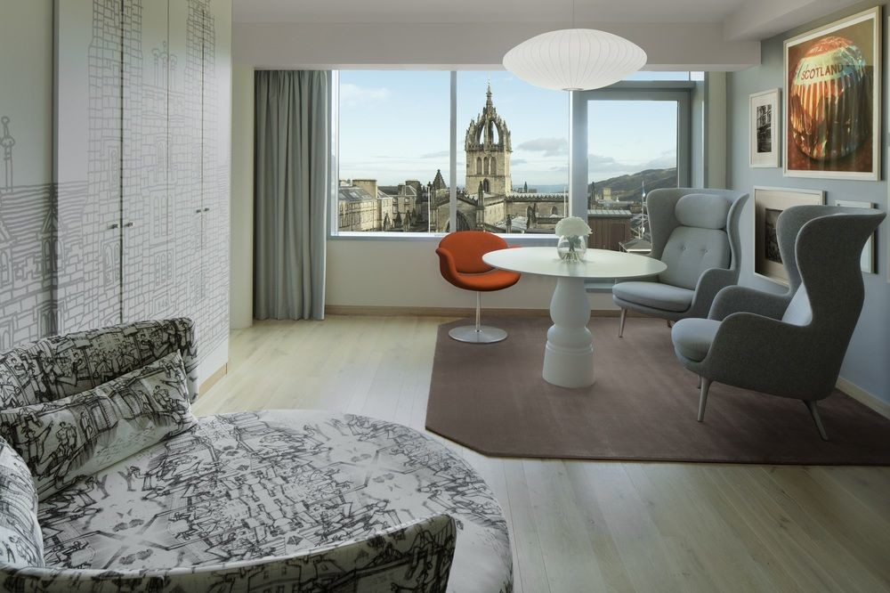 living room with a view at Radisson Collection, Royal Mile