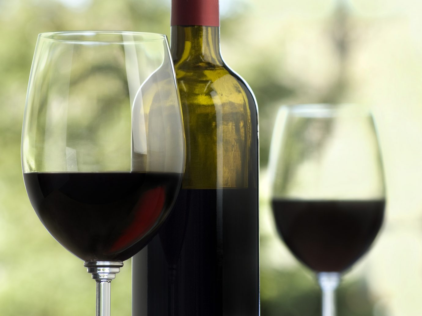 Wine glasses and a bottle containing Cabernet wine