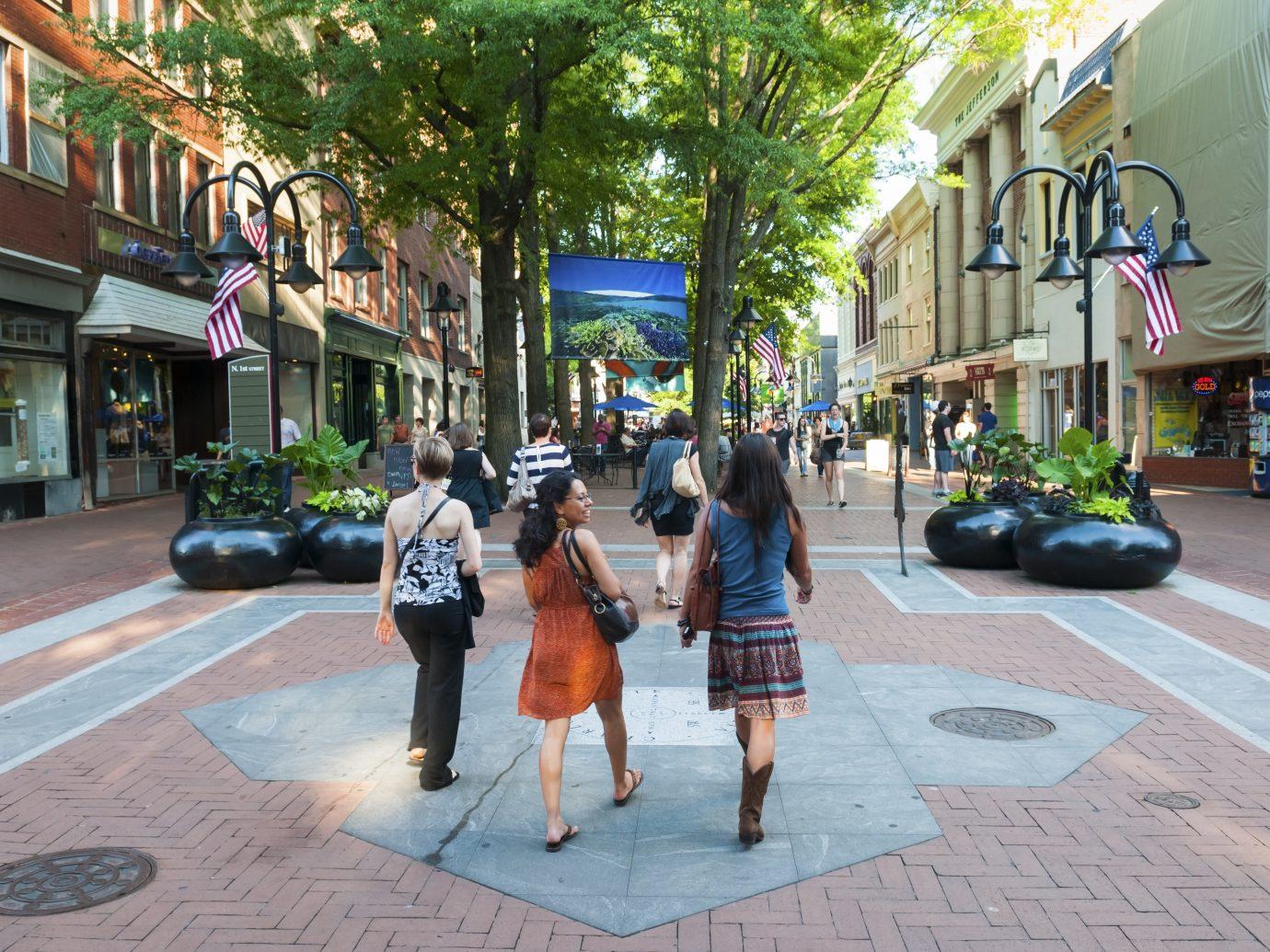 Charlottesville, Virginia, USA - June 7, 2012: Pedestrians enjoy a beautiful summer afternoon in downtown Charlottesville.