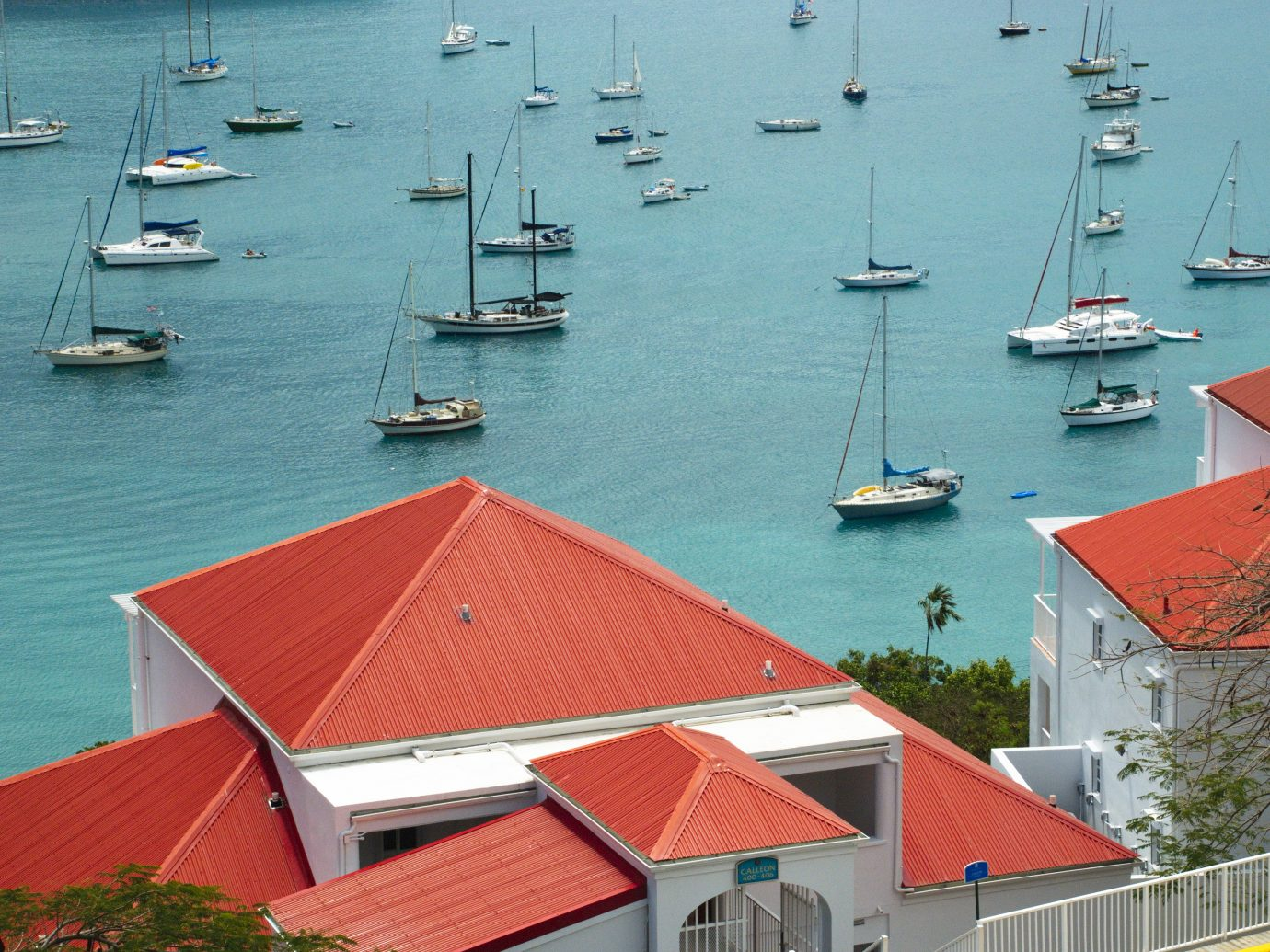 red roof tops overlooking the brilliant turquoise blue Caribbean bay with boats in downtown St. Croix, US Virgin Islands.