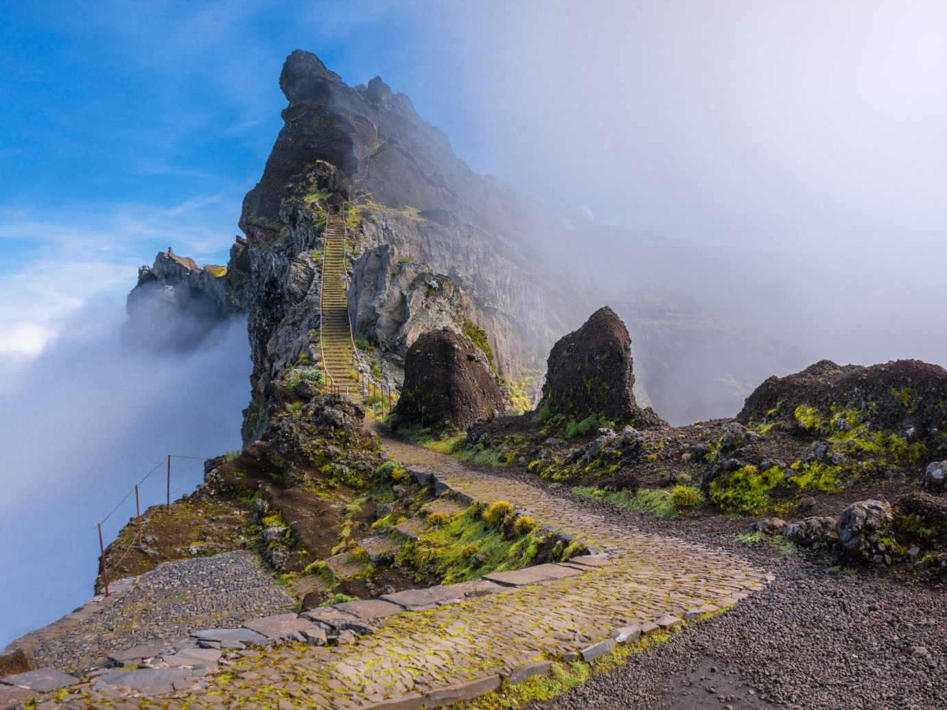mountain trail in Madeira above the clouds on a sunny bright afternoon