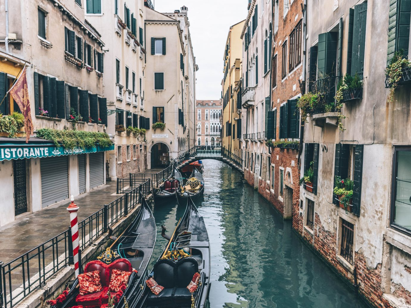 View of boats in a canal in Venice Italy