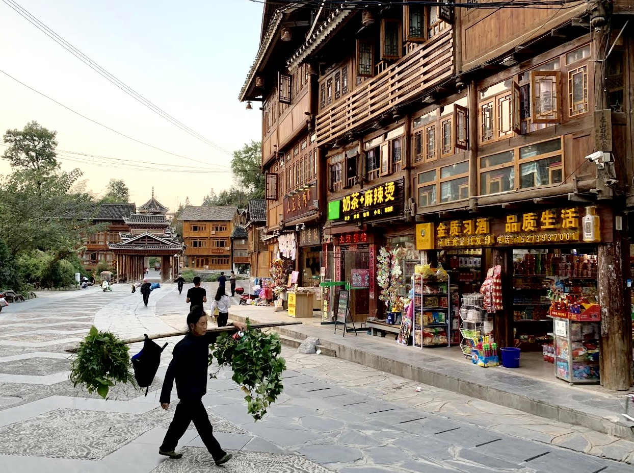 The Dong minority villagers of Zhaoxing perform their evening errands