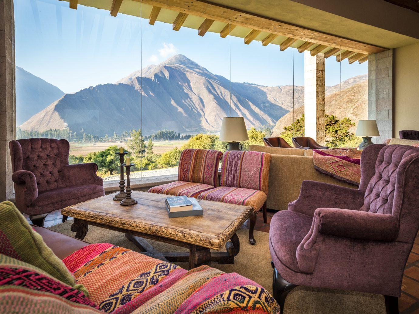 view of mountain from the living room at inkaterra hacienda urubamba