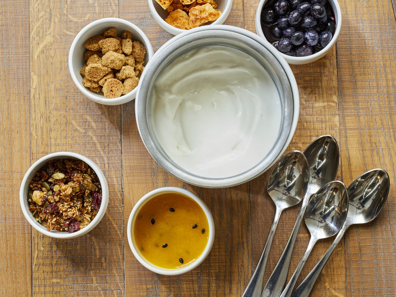 yogurt with numerous options in little bowls to put in it