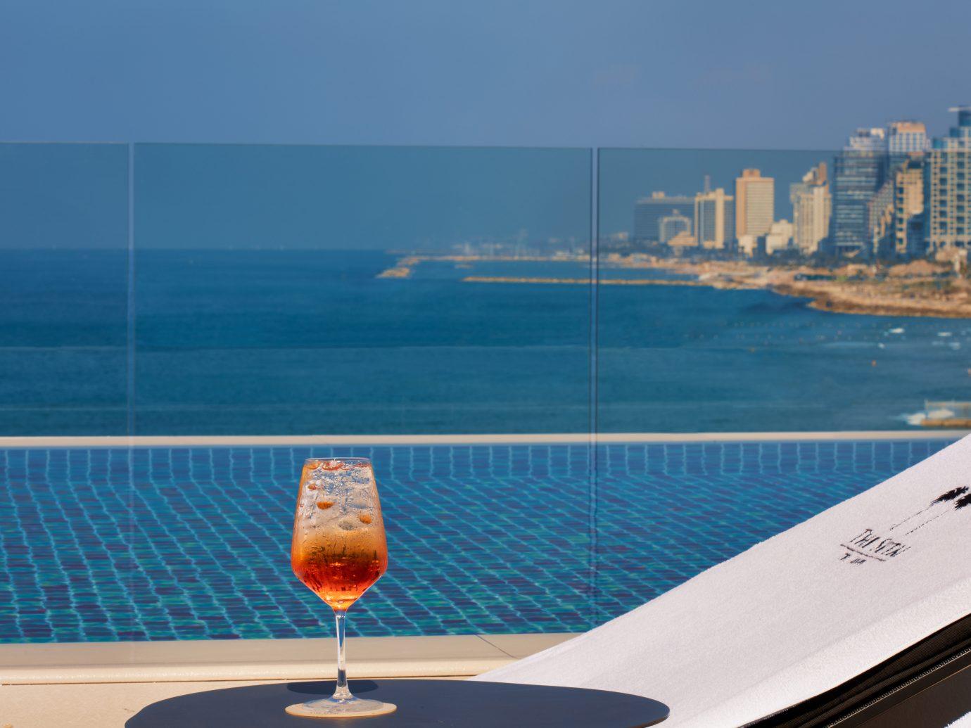 cocktail at the pool at Setai Tel Aviv, Israel