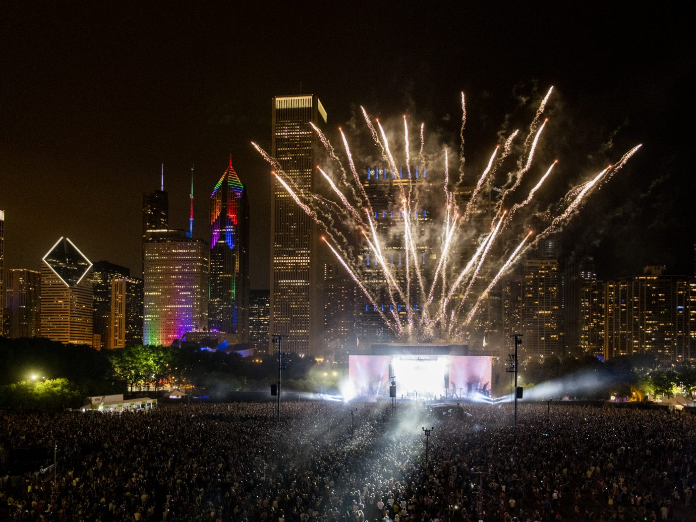 fireworks shooting from stage with Chicago in background