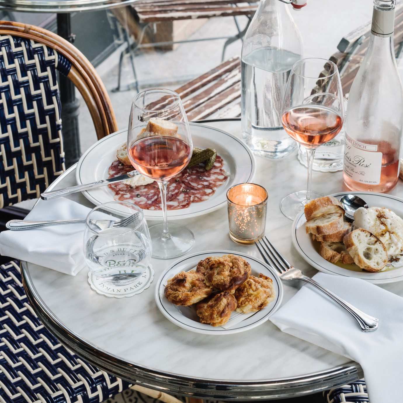 Rose wine and numerous food options on a table