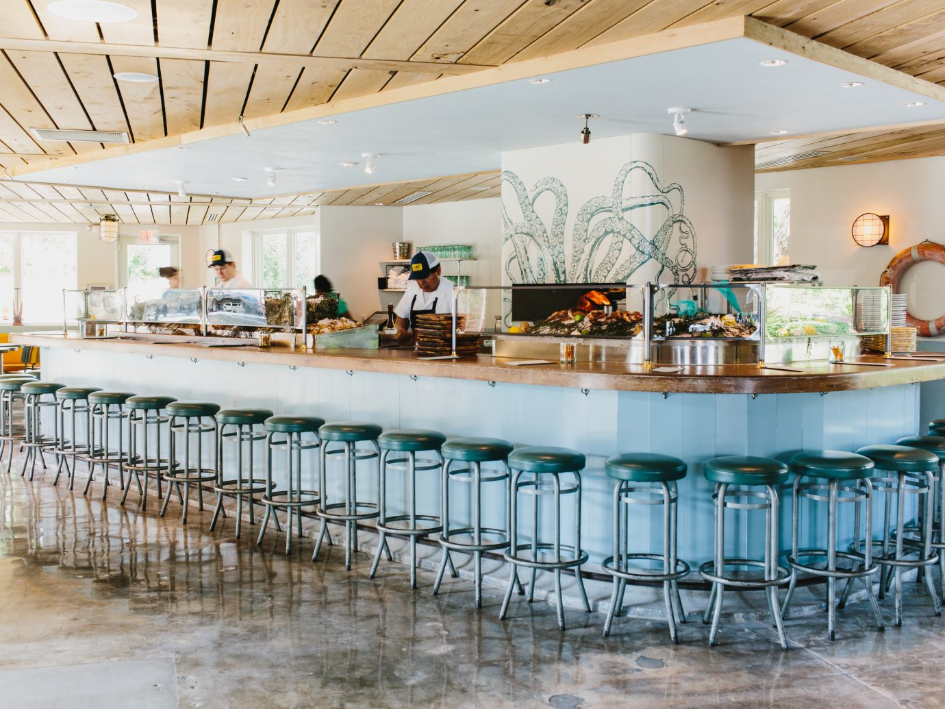 Raw bar with men working