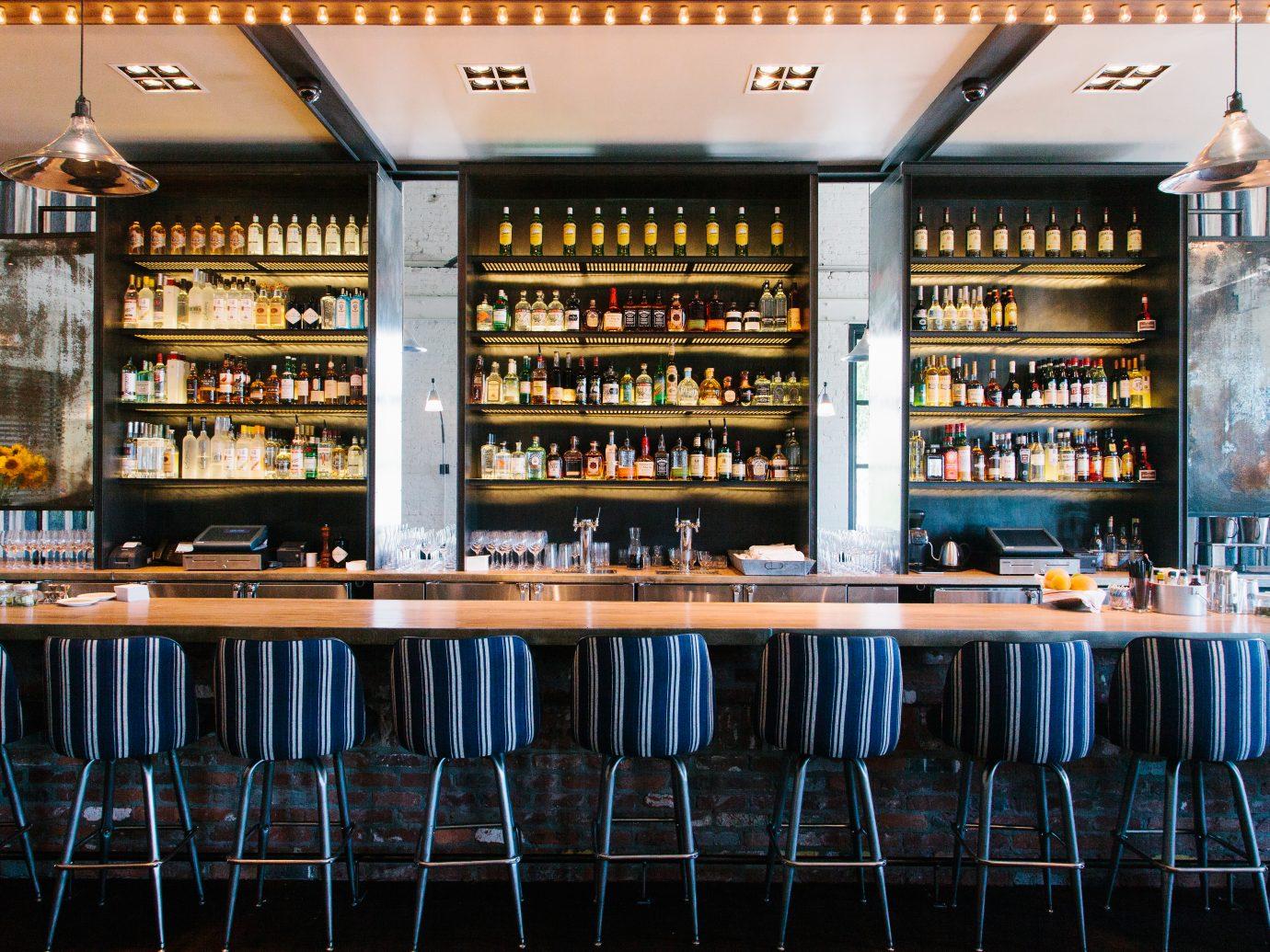 Bar with numerous bottles on shelf