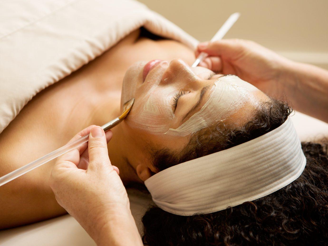 women receiving face mask