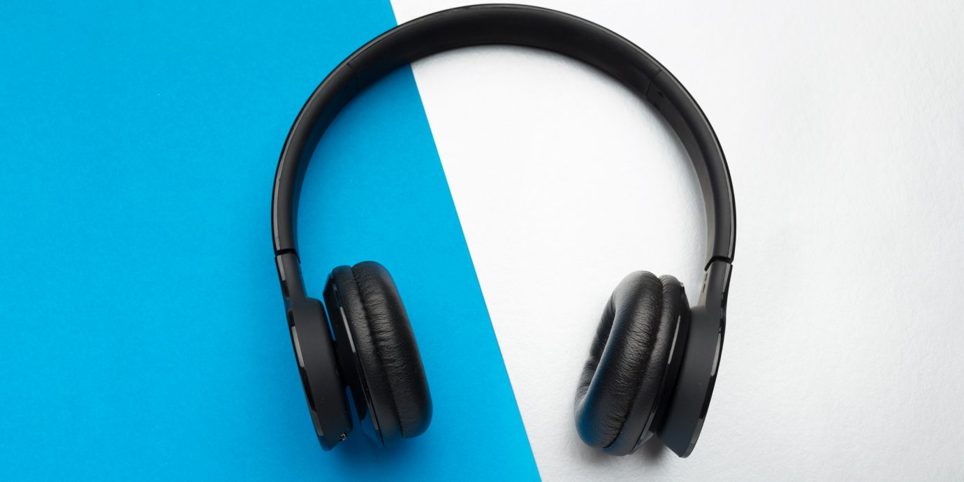 Wireless noise canceling headphones on a graphic background