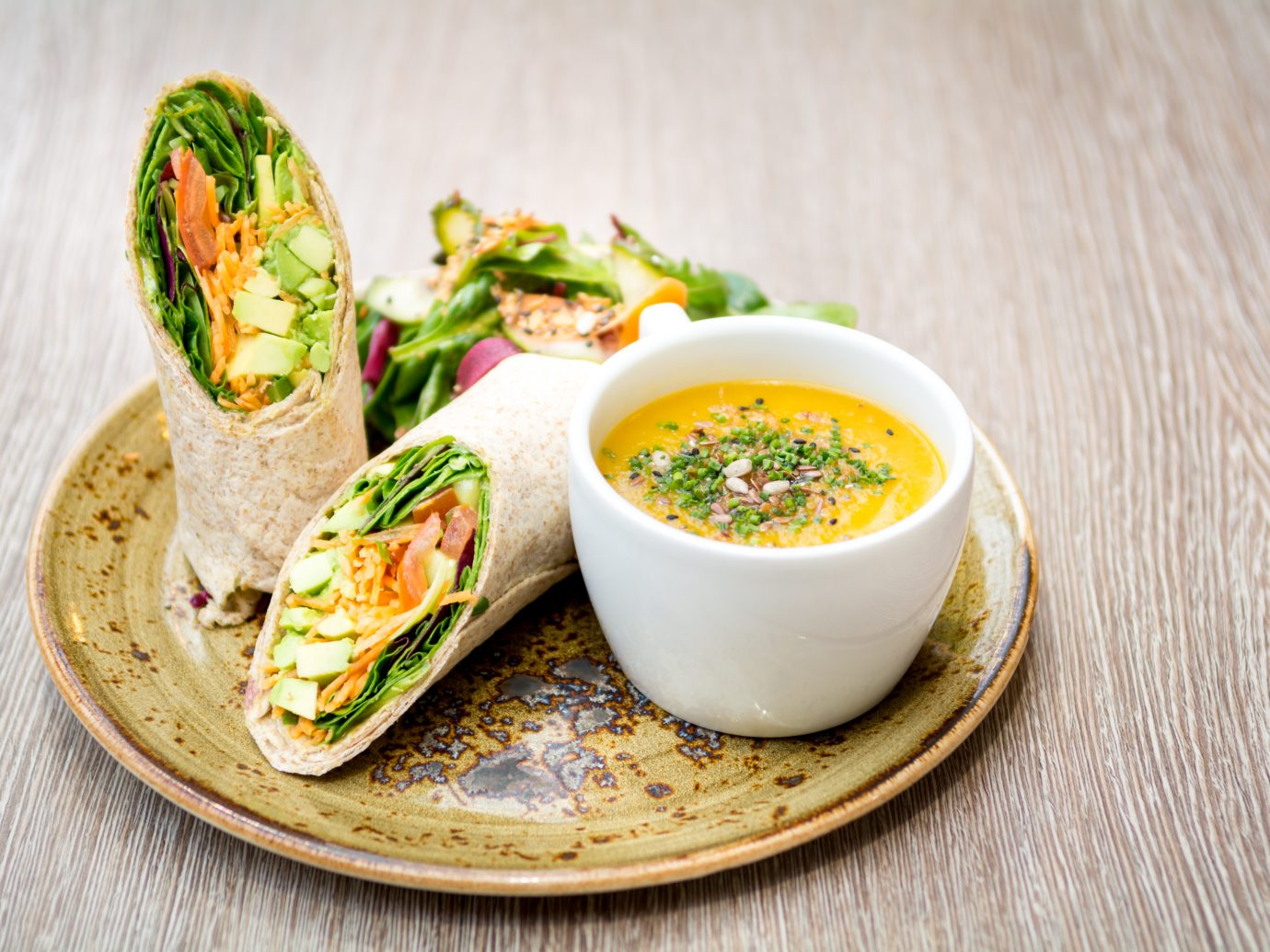 wrap vegetarian sandwich with cup of soup table at Tendresse, Montreal, QC