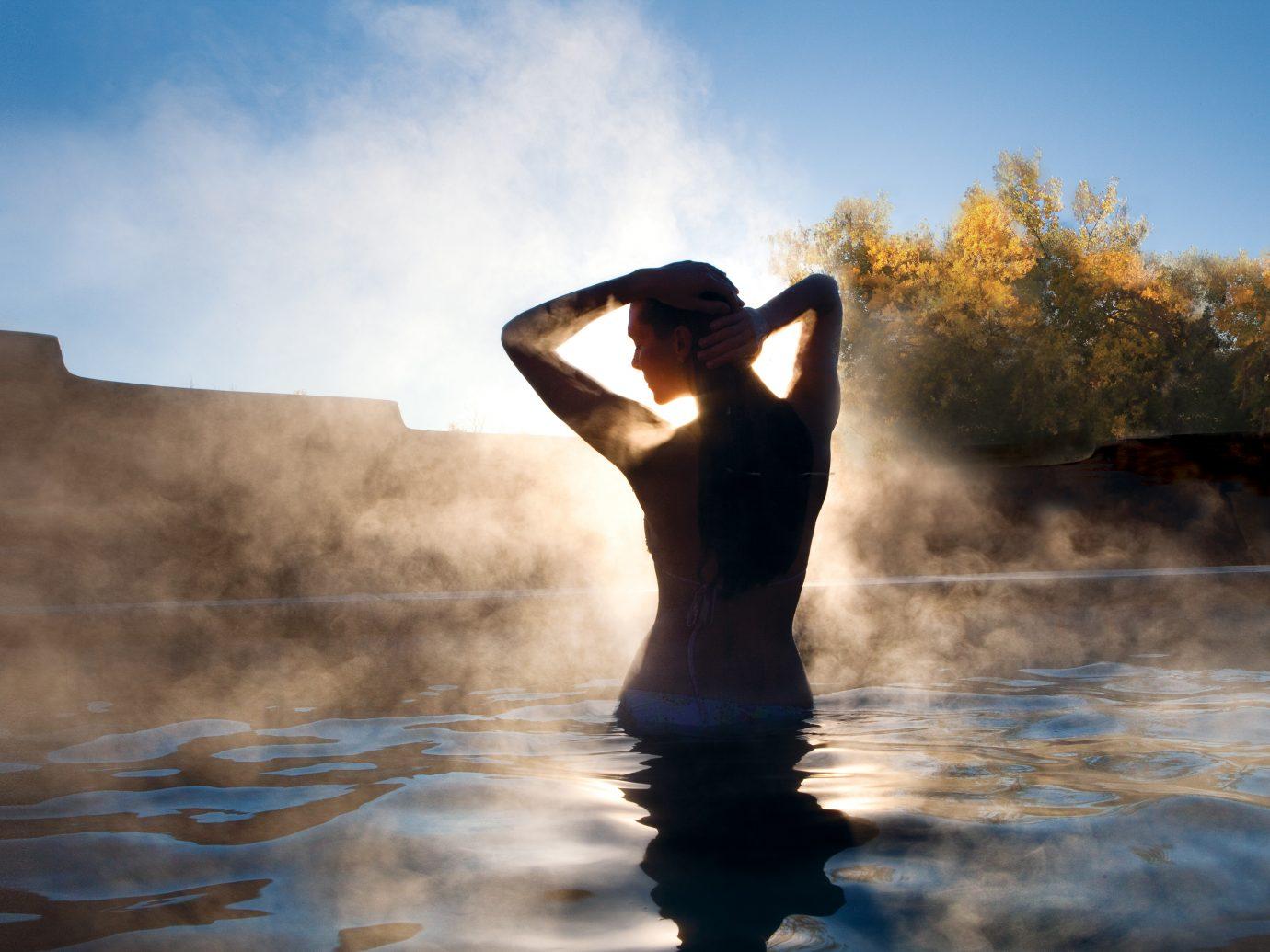 back shot of woman in shadow in springs