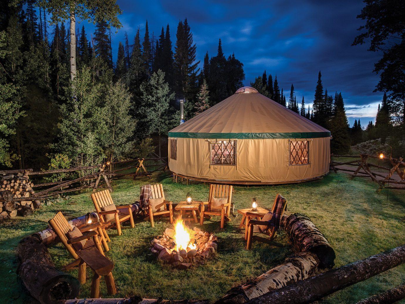 Firepit at night at Brush Creek Ranch