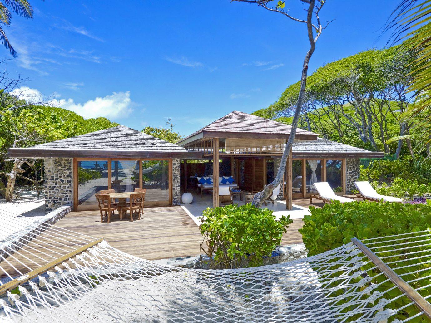 Exterior and hammock at Petit St Vincent Resort