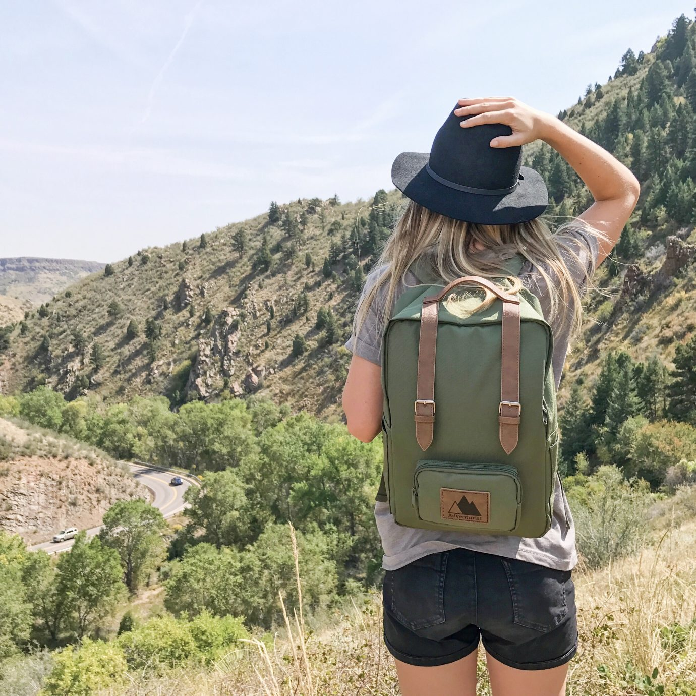 Girl with a backpack on in Denver Colorado