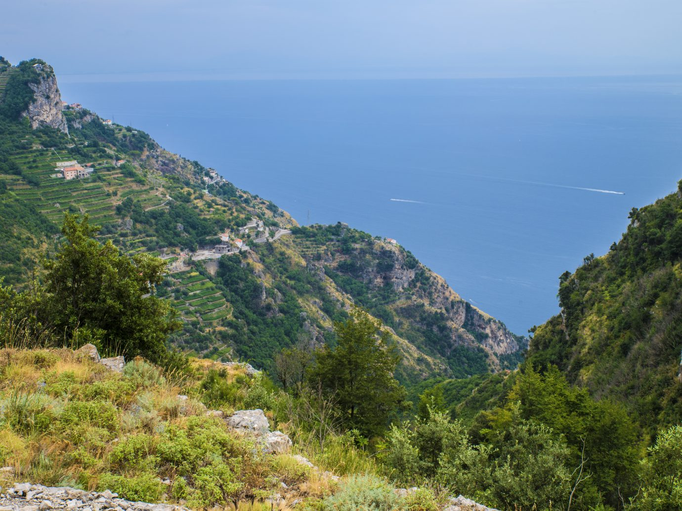 """Hiking trail on the Amalfi Coast: """"Sentiero degli dei"""" (God's way). A view from the trail down to the houses and sea."""