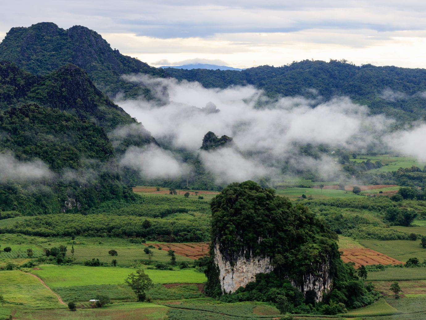 Mountain with fog in morning at Phu langka viewpoint, Phayao, Thailand.