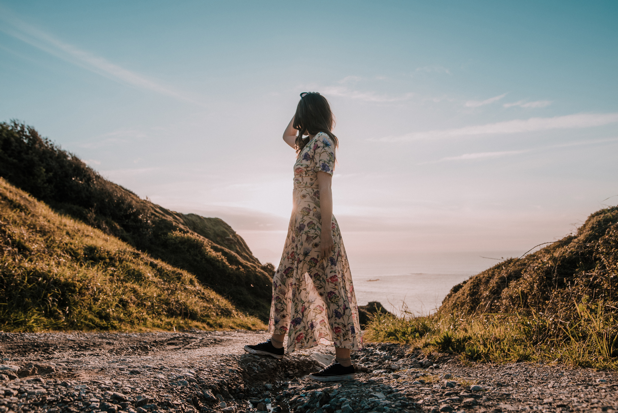 Woman outside in a sundress at sunset