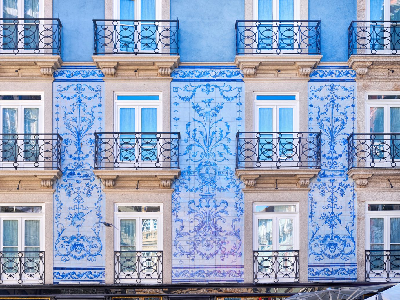 Traditional historic facade in Porto decorated with blue painted tiles, Portugal