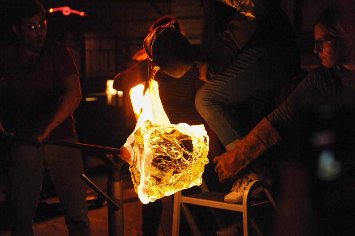 Person blowing glass at Brooklyn Glass